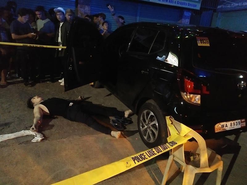 BLOODY WEDNESDAY. Club dancer Angelo Lamboloto Llano, 29, is sprawled on the ground after he was shot dead by a man onboard a black Nissan Navarra. An hour earlier, police shot dead a high-value target in a buy-bust. (Contributed photo)