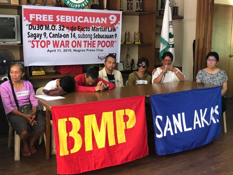 BACOLOD. Families of nine persons tagged in the killing of Councilor Jolomar Hilario in Moises Padilla, Negros Occidental, accompanied by their legal counsel, lawyer Luke Espiritu (4th from left), called on the authorities to release the