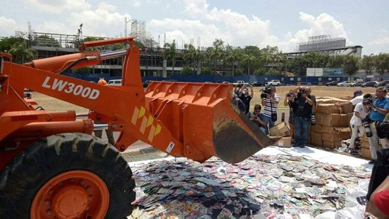 MANILA. Counterfeit items are destroyed by police in Camp Crame on Friday, April 12, 2019. (Third Anne Peralta-Malonzo)