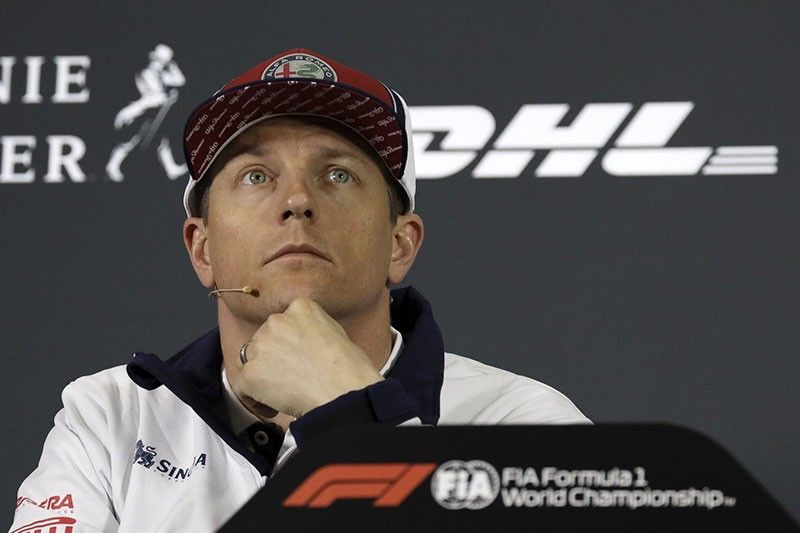 Alfa Romeo driver Kimi Raikkonen of Finland pauses during a press conference at the Shanghai International Circuit ahead of the Chinese Formula One Grand Prix in Shanghai, China, Thursday, April 11, 2019. (AP Photo)