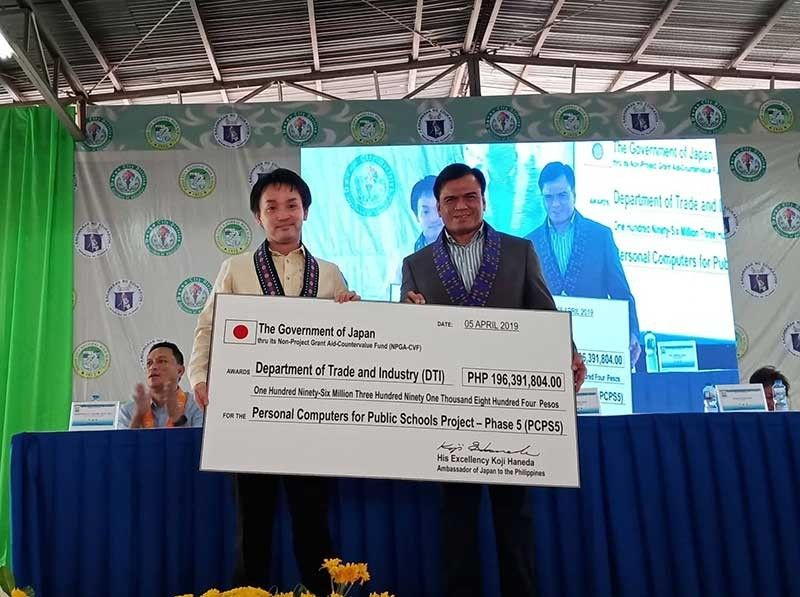 DAVAO. Japan representative Takahiko Shiba handed last April 5, 2019 to the Department of Trade and Industry (DTI) a check amounting to more than P196 million for the 380 school beneficiaries of the Personal Computers for Public Schools (PCPS) Project phase 5 in Visayas and Mindanao, including the Davao City National High School (DNCHS) where the launching was held. (Photo by Lyka Casamayor)