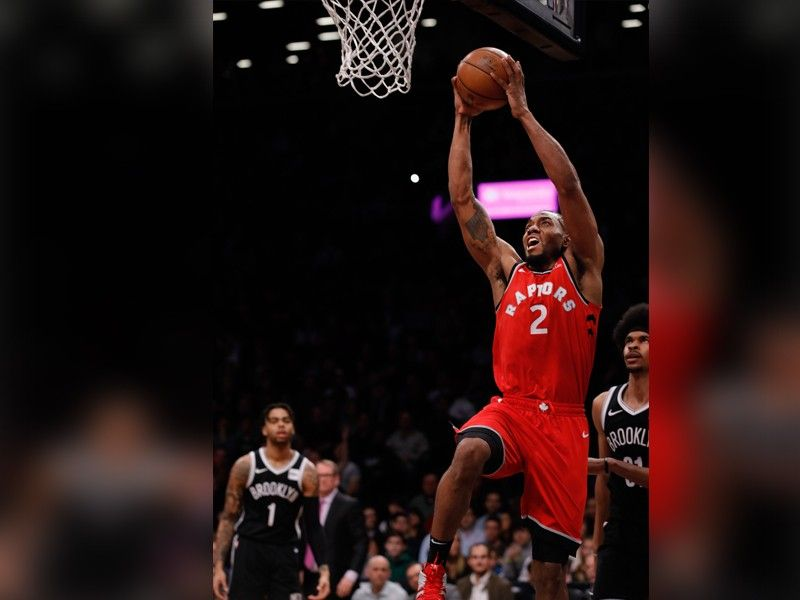 Toronto Raptors forward Kawhi Leonard goes up for a dunk during the first half of the NBA basketball game against the Brooklyn Nets, Wednesday, April 3, 2019, in New York. (AP Photo)