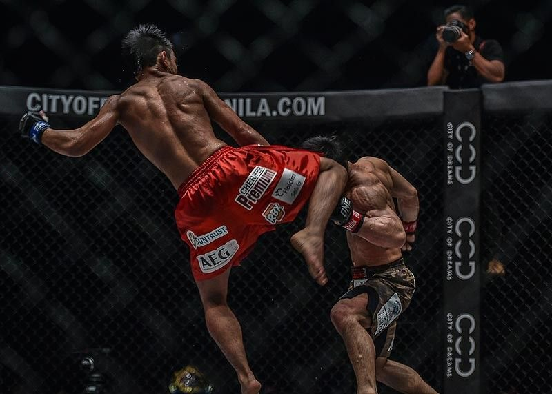 SLEEPER KISSER. Joshua Pacio connects with a kick to the head to stop Yosuke Saruta in their rematch during the co main event of One Championship's 'Roots of Honor' at the Mall of Asia Arena Friday evening and reclaim the ONE strawweight world title. 	(ONE Championship photo)