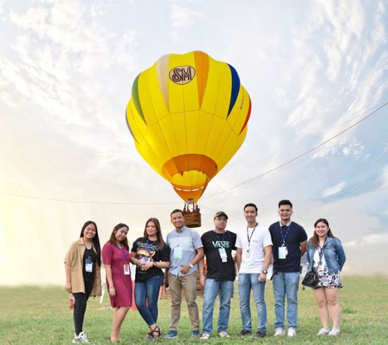 Executives of SM City Clark, led by Mall Manager Andrea Madlangbayan, Assistant Mall Manager Ronald Abrazado and Public Relations Manager Venus Manalang, pose during the Hot Air Balloon Festival in Clark Freeport over the weekend.