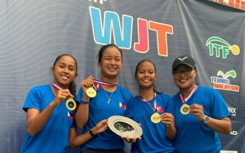 CHAMPION: The members of Team Philippines show their medals after winning the World Junior Tennis Championships Asia-Oceania Final Qualifying tournament in Kuala Lumpur, Malaysia on Saturday (April 13, 2019). From left are Jenaila Rose Prulla, Alexandra Eala, Alexa Joy Milliam and coach Czarina Mae Arevalo. (Contributed photo)