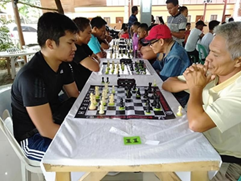 NM TOLENTINO, at left, during the Kaamulan Festival Open chess tournament in Malaybalay City, Bukidnon. (Supplied Photo)