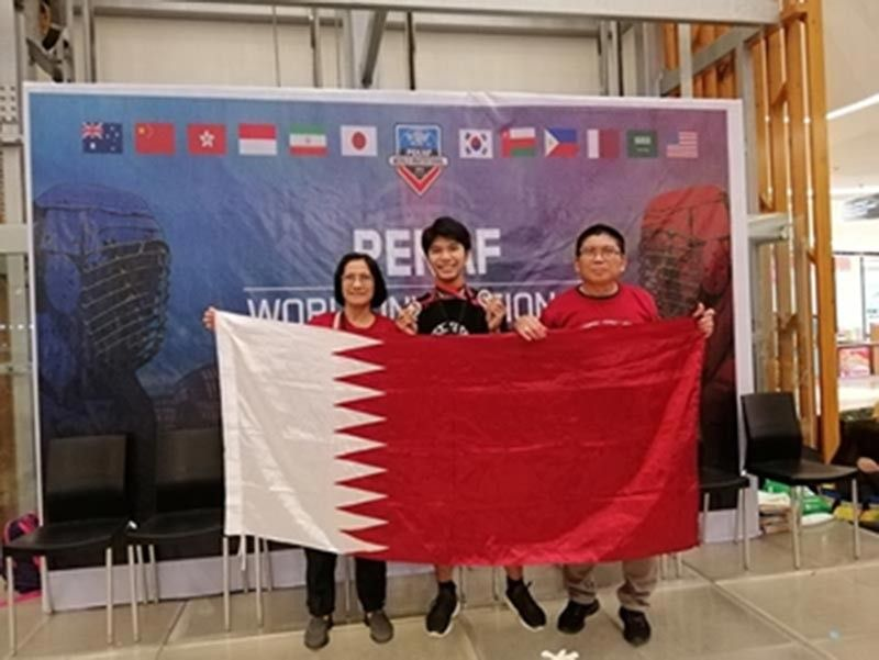 MISSION. Grandmaster Jose Eric Mosqueda (right) with wife Gigi (left) and student John Bernard Romanes (center) during the Pekaf World Invitational Championships. (Contributed photo)