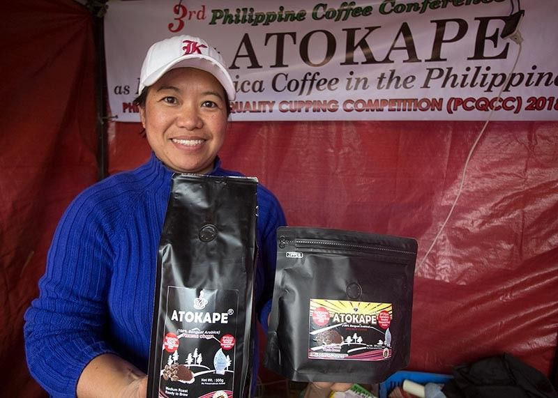 BENGUET. Beth Oliem from Caliking Atok sells ATOKAPE, a product of Atok Arabica Coffee Growers Marketing Cooperative (ATACOGMAC). The southern part of Atok is known to produce high quality vegetables and coffee. (Photo by Jean Nicole Cortes)