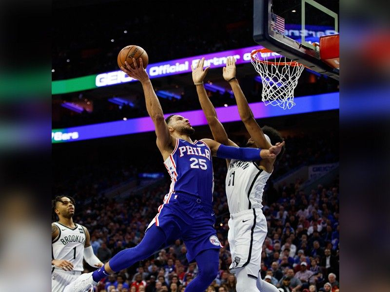 Philadelphia 76ers' Ben Simmons, left, of Australia, goes up for the shot against Brooklyn Nets' Jarrett Allen, right, during the first half in Game 2 of a first-round NBA basketball playoff series, Monday, April 15, 2019, in Philadelphia. (AP Photo)