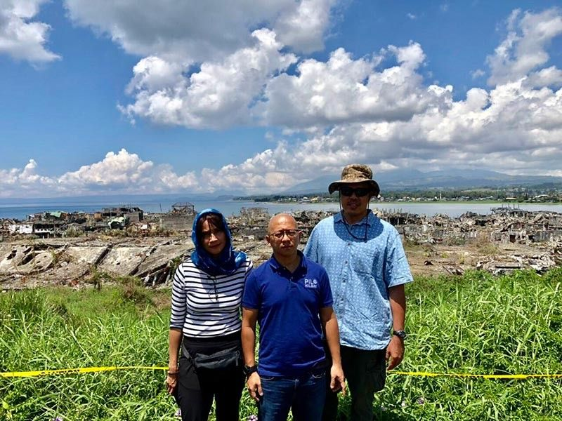 MARAWI. Agot Isidro, Pilo Hilbay, and my spouse at ground zero in Marawi. (Hannah Wabe)