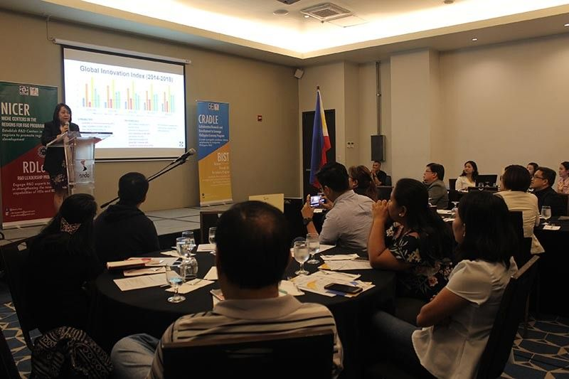 BACOLOD. DOST Undersecretary for Regional Operations Brenda Nazareth-Manzano (standing) speaks at the Forum on Business Innovation through Science and Technology (BIST) for Industry Program at Seda Capitol Central in Bacolod City Tuesday, April 16, 2019. (PIA-Negros Occidental)