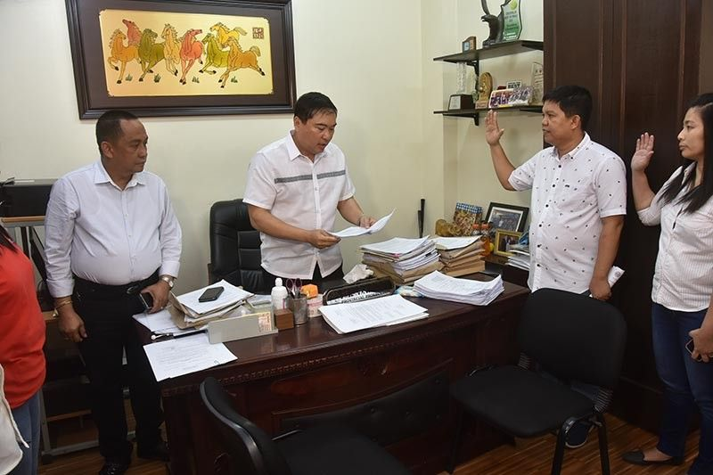 PAMPANGA. Provincial Administrator Andres Pangilinan Jr. (left), together with Provincial Information Officer Joel Mapiles and Management Information Systems Office head Marylou Espaltero, formally files administrative and criminal charges against Diosdado Macapagal Memorial Hospital Administrator Eddie Ponio before the Provincial Prosecutor's Office on Monday afternoon, April 15. Ponio is accused of having printed campaign materials for his brother at the hospital's information system office. (Contributed Photo)