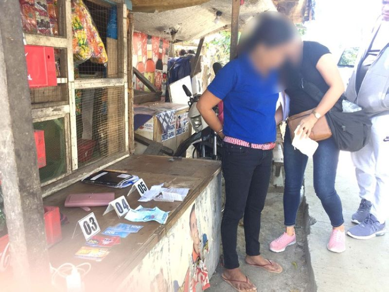 CEBU. A 45-year-old woman (wearing blue shirt) was arrested by law enforcement operatives after she was caught selling her children to online pedophiles in Mandaue City earlier today, April 16. Five of her children have been rescued and placed under care by the Department of Social Welfare and Development. (Contributed foto)