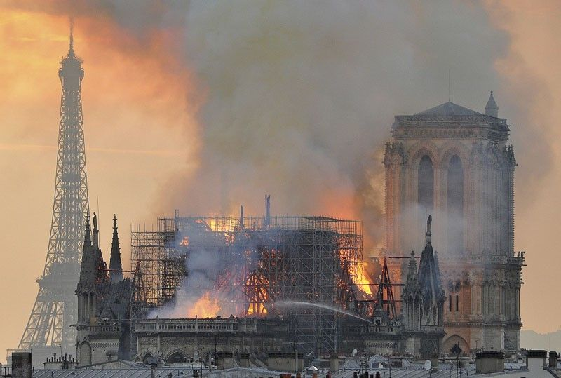 FRANCE. In this image made available on Tuesday April 16, 2019 flames and smoke rise from the blaze after the spire toppled over on Notre Dame cathedral in Paris, Monday, April 15, 2019. An inferno that raged through Notre Dame Cathedral for more than 12 hours destroyed its spire and its roof but spared its twin medieval bell towers, and a frantic rescue effort saved the monument's
