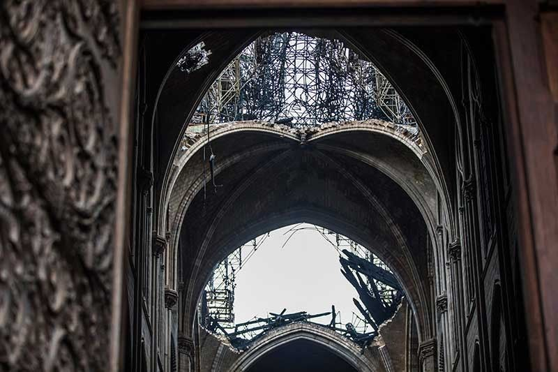 PARIS. Holes seen in the dome inside the damaged Notre Dame cathedral in Paris, Tuesday, April 16, 2019. Firefighters declared success Tuesday in a more than 12-hour battle to extinguish an inferno engulfing Paris' iconic Notre Dame cathedral that claimed its spire and roof, but spared its bell towers and the purported Crown of Christ. (Christophe Petit Tesson, Pool via AP)
