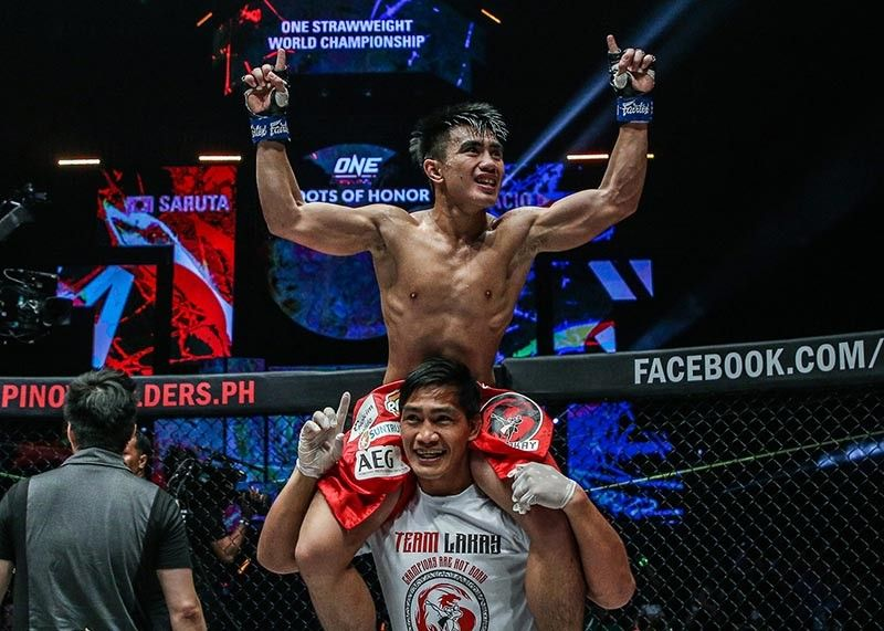MANILA. Joshua Pacio gets a piggy back ride from former ONE lightweight world champion Eduard Folayang after his conquest of Yosuke Saruta to reclaim the promotions strawweight world title last week. (ONE photo)