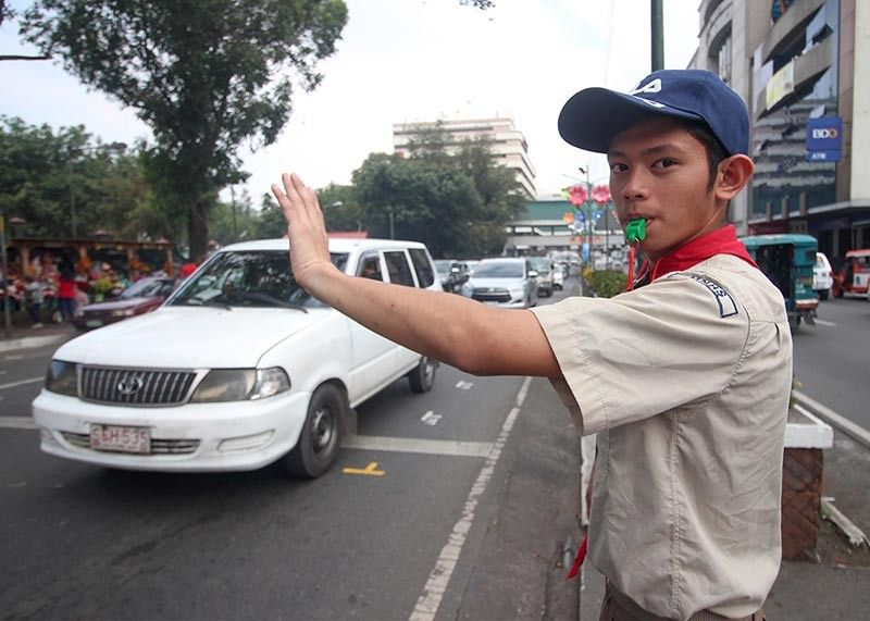 BAGUIO. A Boy Scout mans traffic along Harrison Road from April 16-21 as part of their annual Summer Vacation (SUMVAC) Service Camp. Photo by Jean Nicole Cortes