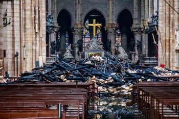 FRANCE. A hole is seen in the dome inside Notre Dame cathedral in Paris, Tuesday, April 16, 2019. Firefighters declared success Tuesday in a more than 12-hour battle to extinguish an inferno engulfing Paris' iconic Notre Dame cathedral that claimed its spire and roof, but spared its bell towers and the purported Crown of Christ. (AP)