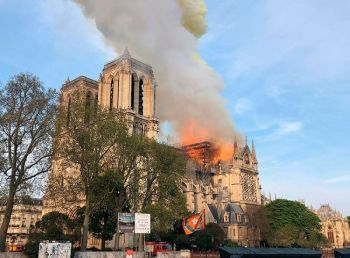 FRANCE. Notre Dame Cathedral is burning in Paris, Monday, April 15, 2019. Massive plumes of yellow brown smoke is filling the air above Notre Dame Cathedral and ash is falling on tourists and others around the island that marks the center of Paris. (AP)