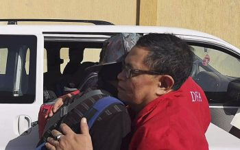 LIBYA. In this Wednesday, April 17, 2019, photo released by the Department of Foreign Affairs, a Filipino worker embraces a staff of the department as they are evacuated from Tripoli, Libya. Philippine diplomats started evacuating a small group of Filipinos from the Libyan capital after it was hit by a barrage of rocket fire that wounded one Filipino, officials said Thursday, April 18, 2019. (AP)