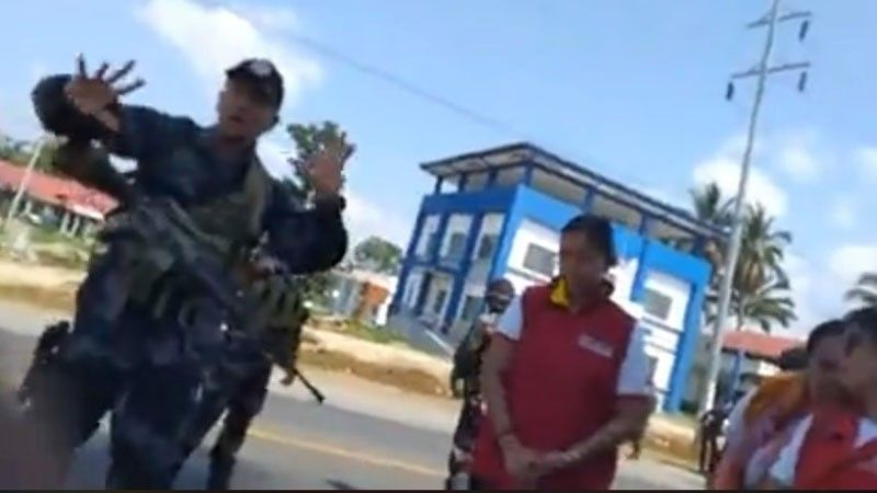 "CAGAYAN DE ORO. A video screen capture from one of the members of ""Kalbaryo sa Kabus (ordeal of the poor)"" partly shows an exchange of arguments between its members and police officers and the municipal social workers of Manolo Fortich, Bukidnon, on Friday, April 19. Authorities want the children to be kept within the municipal social workers' compound if the group decides to continue their protests going to Cagayan de Oro. (Video courtesy of Kalbaryo sa Kabus)"