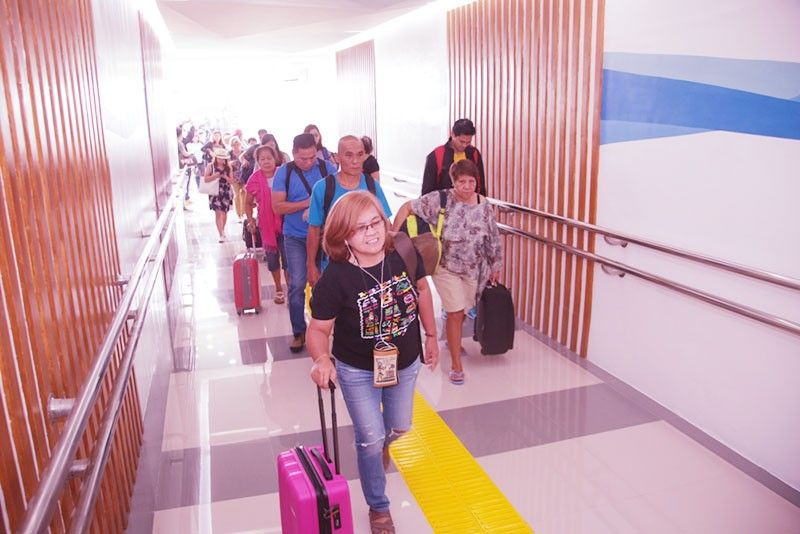 CLARK. Passengers pass through the newly-opened and renovated Domestic Arrival Gangway leading to the Baggage Claim Area of the Clark International Airport (CRK) Domestic Arrival Terminal. Developed through funds allocated by the Bases Conversion and Development Corporation (BCDA), the gangway provides a more convenient and safer passageway for arriving passengers of domestic flights. (CIAC–CCO Photo)