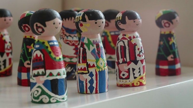 TRIBE-INSPIRED. Scrap wood are turned into wooden dolls painted in costumes of Mindanao tribes. (Photo from Swito Innovation Hub)