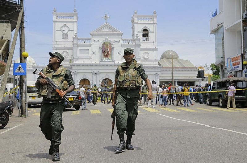 Sri Lankan Army soldiers secure the area around St. Anthony's Shrine after a blast in Colombo, Sri Lanka, Sunday, April 21, 2019. A Sri Lanka hospital spokesman says several blasts on Easter Sunday have killed dozens of people. (AP Photo)