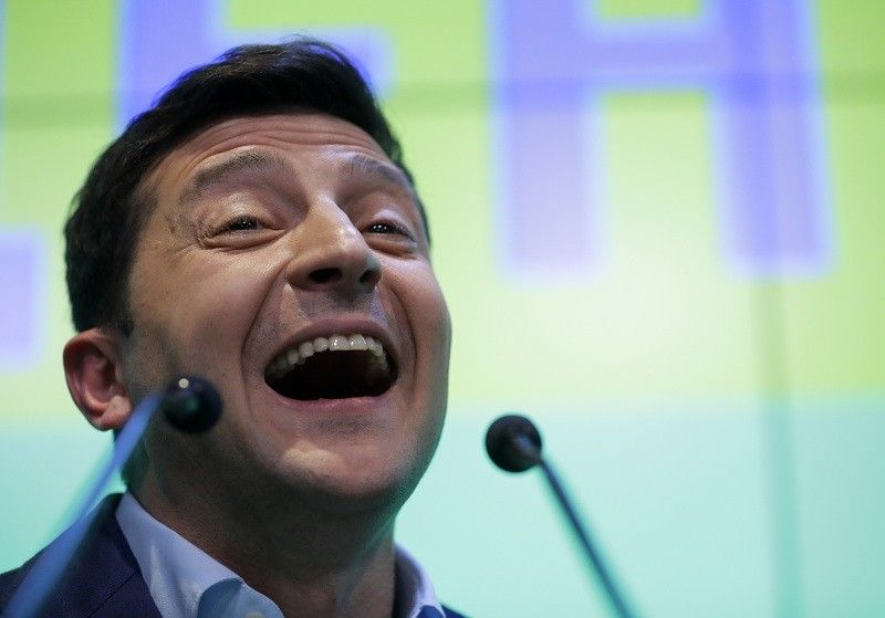 UKRAINE. Ukrainian comedian and presidential candidate Volodymyr Zelenskiy speaks to the media and his supporters at his headquarters after the second round of presidential elections in Kiev, Ukraine, Sunday, April 21, 2019. A comedian whose only political experience consists of playing a president on TV appeared poised to reprise the role in real life when an exit poll showed him winning Ukraine's presidential runoff Sunday in a landslide. (AP)
