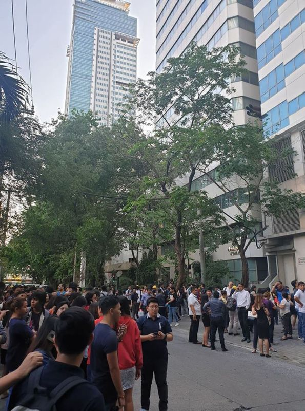 MANILA. Office workers at Hanston Square in Pasig City were asked to evacuate the building. (Photo courtesy of Fiona Villamor)