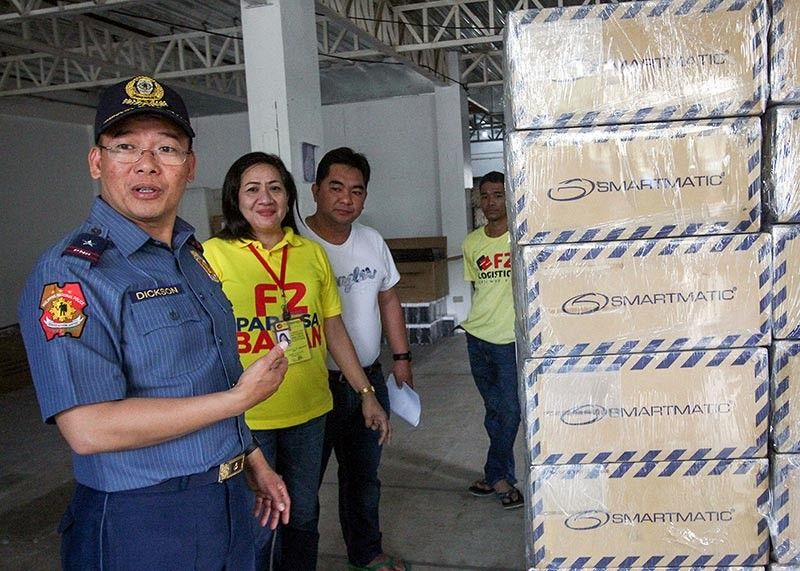 BAGUIO. PRO-Cordillera Director Police Brigadier General Israel Ephraim Dickson inspects the vote counting machines in a warehouse in Baguio City to ensure safety and security for the upcoming national and local elections. (Jean Nicole Cortes)