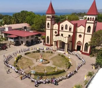 "BACOLOD. This the aerial shot of the human chains launched in the Diocese of San Carlos Borromeo Cathedral in San Carlos City which was simultaneously done in the Dioceses from Manapla to La Libertad in Negros Oriental on April 22, opposing the entry of the coal-fired power plant as proposed by San Miguel Corporation. (Photo by Ramoncito ""C2y"" Taño)"