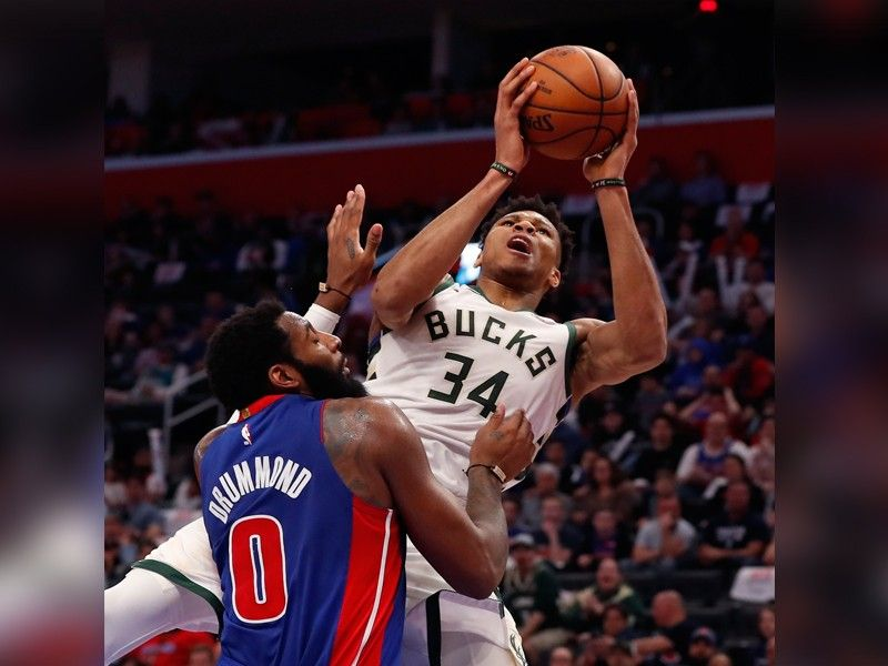 Milwaukee Bucks forward Giannis Antetokounmpo (34) is fouled by Detroit Pistons center Andre Drummond (0) during the first half of Game 4 of a first-round NBA basketball playoff series, Monday, April 22, 2019, in Detroit. (AP)