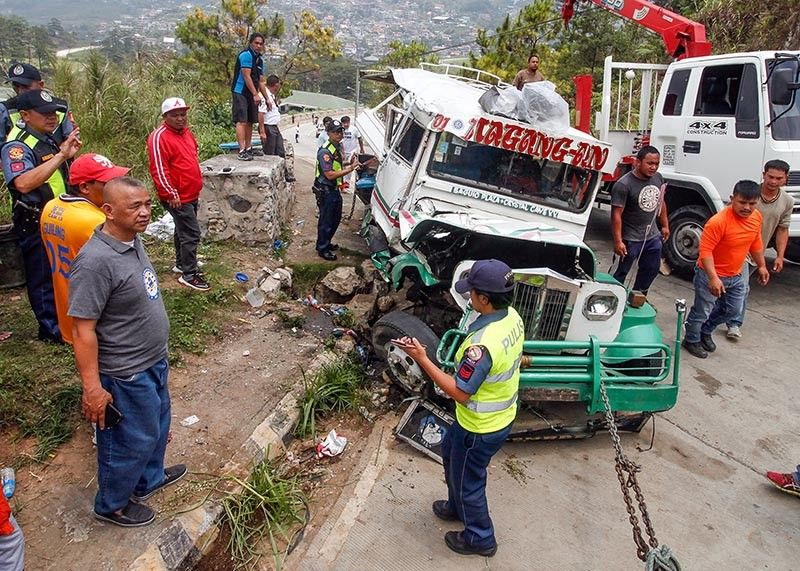 BAGUIO. The jeepney ridden by supporters of a Baguio congressional candidate is being hauled out of the main road after ramming to stone barriers in front of the gate 2 of Pinewoods Subdivision 9:45 a.m. of April 23. (Photo by Jean Nicole Cortes)