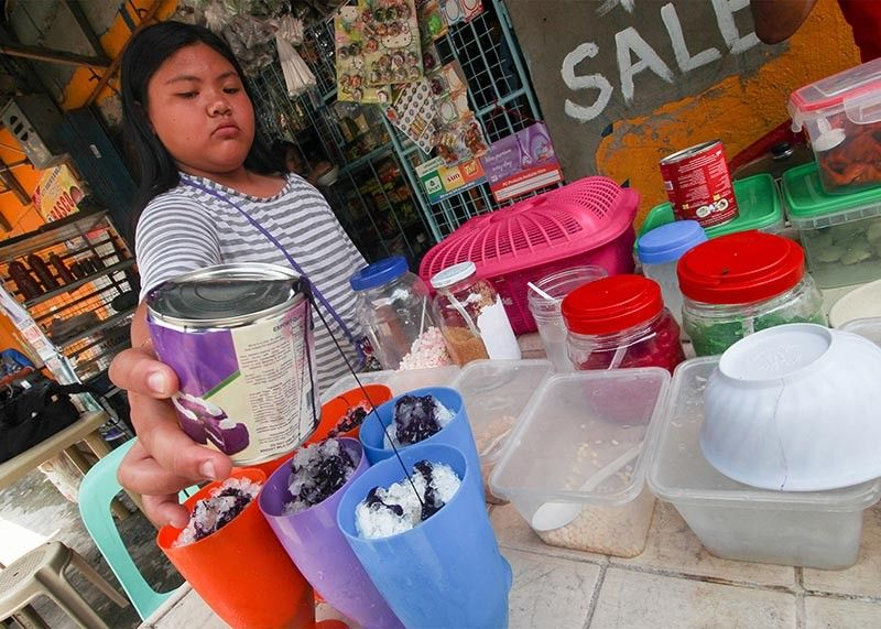 BAGUIO. Due to the scorching heat brought by summer, halo-halo or mixed ice snack is fast becoming a popular snack not only in the lowlands but also in the highland towns of Benguet. (Photo by Jean Nicole Cortes)