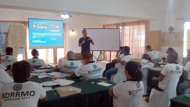 PREACHING PREPAREDNESS. Cloyd Dedicatoria, managing director of SugboTek, explains to barangay disaster officers the features of Guardian Emergency Response, a mobile phone-based app that  could be used in times of emergency. (Contributed photo)