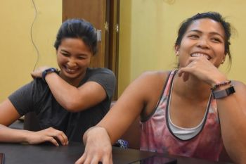 DAVAO. Patrimonio sisters, Anna Christine and Anna Clarice, share a light moment during an interview at Hotel Elena Tuesday afternoon, April 23, 2019. (Marianne L. Saberon-Abalayan)
