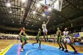 OPEN LANE.A Mandaue City player (in white jersey) soars for a layup after escaping the Consolacion Sarok Weavers defenders. Mandaue City will play Samboan today. (File photo / Alex Badayos)