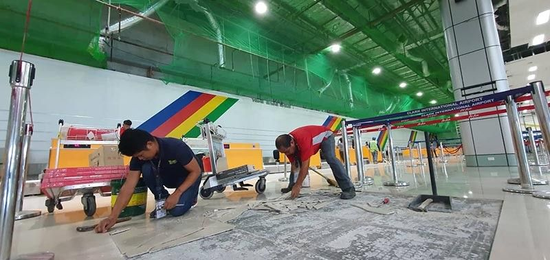 PAMPANGA. Forty-eight hours after the earthquake, the Clark International Airport Corporation resumes operation Wednesday afternoon, April 24, after putting up safety nets and removing the collapsed ceiling. (Chris Navarro)
