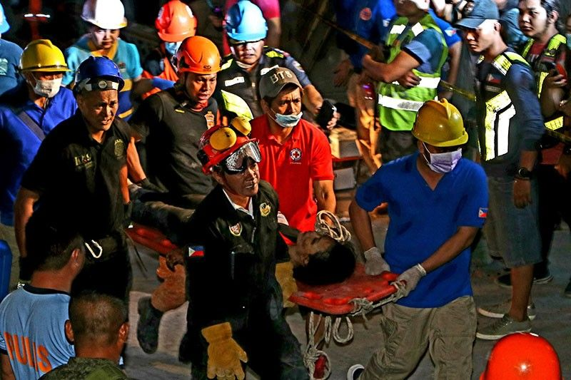 PAMPANGA. Rescuers revive an earthquake victim who was pulled out of the collapsed Chuzon Supermarket in Porac, Pampanga last Monday, April 22, 2019. The woman employee was later taken to the JBL hospital for treatment. (Photo by Chris Navarro)