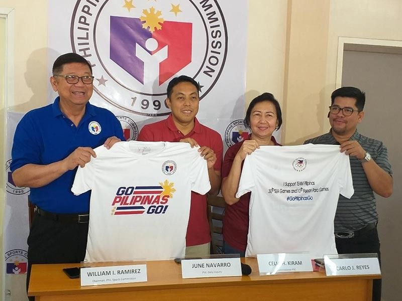 "DAVAO. From left, Philippine Sports Commission (PSC) chairman William ""Butch"" Ramirez, June Navarro, PSC commissioner Charles Raymond A. Maxey and Carlo Reyes, during a press conference yesterday, show the free dri-fit shirts to be given away during the Go Pilipinas Go concert rally set Monday that aims to cheer the 30th Southeast Asian (SEA) Games-bound Filipino athletes. (Marianne L. Saberon-Abalayan)"
