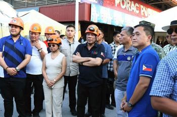 PAMPANGA. In this April 23 photo released by the Malacanang Presidential Photographers Division, President Rodrigo Duterte (center) stands beside House Speaker Gloria Macapagal-Arroyo (third from left) as they visit an earthquake-damaged building where rescuers continue operations for trapped people in Porac town, Pampanga. (AP)