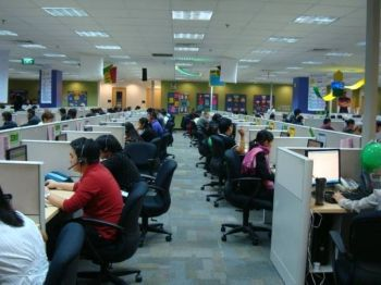 BACOLOD. Like Iloilo and Sta. Rosa, Bacolod City is no longer included in the Top 100 Super Cities list of global consulting firm Tholons International. In the photo, employees of one of the IT-BPO firms in the city. (Contributed Photo)