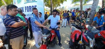 AKLAN. Department of Environment and Natural Resources Secretary Roy Cimatu tries the electronic motorcycle donated by Star8. (Contributed photo)