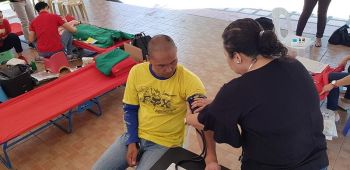 CAGAYAN DE ORO. A physician (standing) checks up the blood pressure of a volunteer who wishes to donate blood to the Philippine Red Cross. The blood-letting program was initiated by SunStar Cagayan de Oro's sister publication, Super Balita, as part of its 22nd year anniversary celebration. (Nef Luczon)