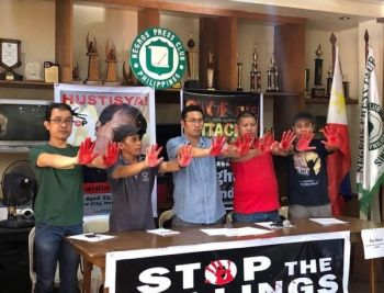 BACOLOD. Some members of militant groups in Negros Occidental raise their hands with red paint as they call for the stoppage of killings during the press briefing held at the Negros Press Club in Bacolod City Thursday. (Contributed Photo)