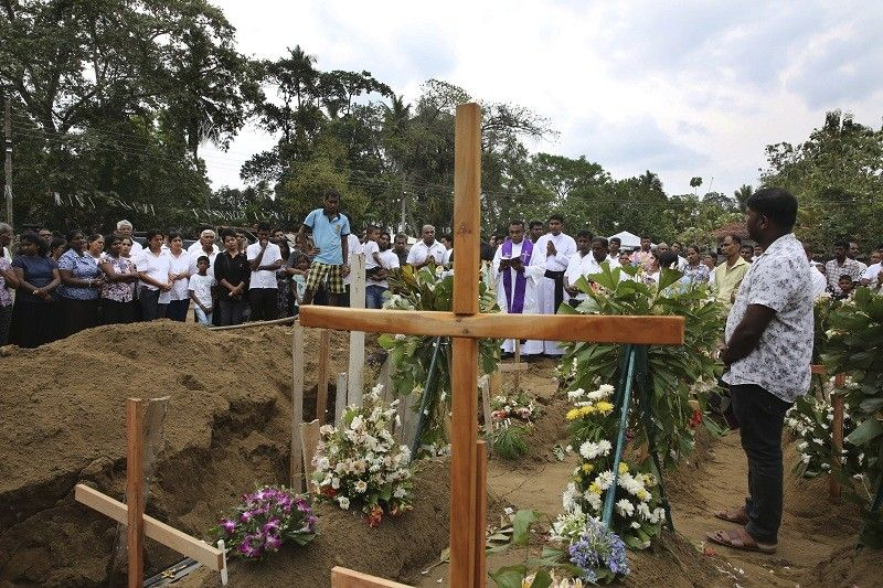 SRI LANKA. A priest conducts funeral service for a victim of Easter Sunday's bomb blast at St. Sebastian Church, in Negombo, Sri Lanka Thursday, April 25. The U.S. Embassy in Sri Lanka warned Thursday that places of worship could be targeted for militant attacks over the coming weekend, as police searched for more suspects in the Islamic State-claimed Easter suicide bombings that killed over 350 people. (AP)
