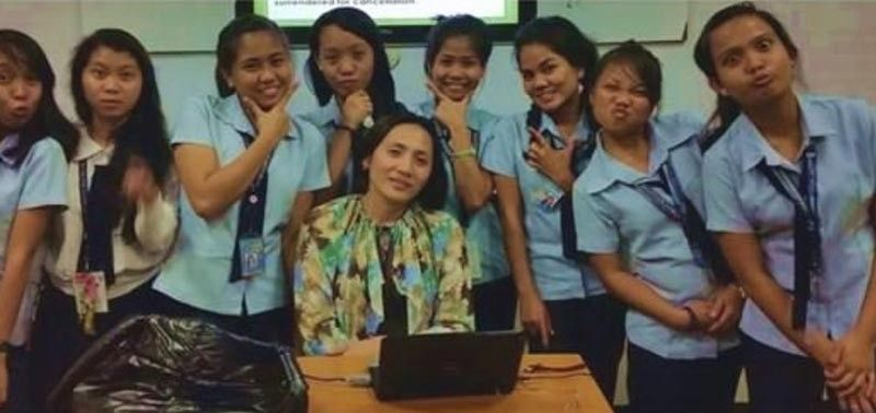 BACOLOD. Atty. Belinda Siason -Villa with her students at Carlos Hilado Memorial State College (CHMSC) at Fortune Town, Brgy. Estefania, Bacolod City.
