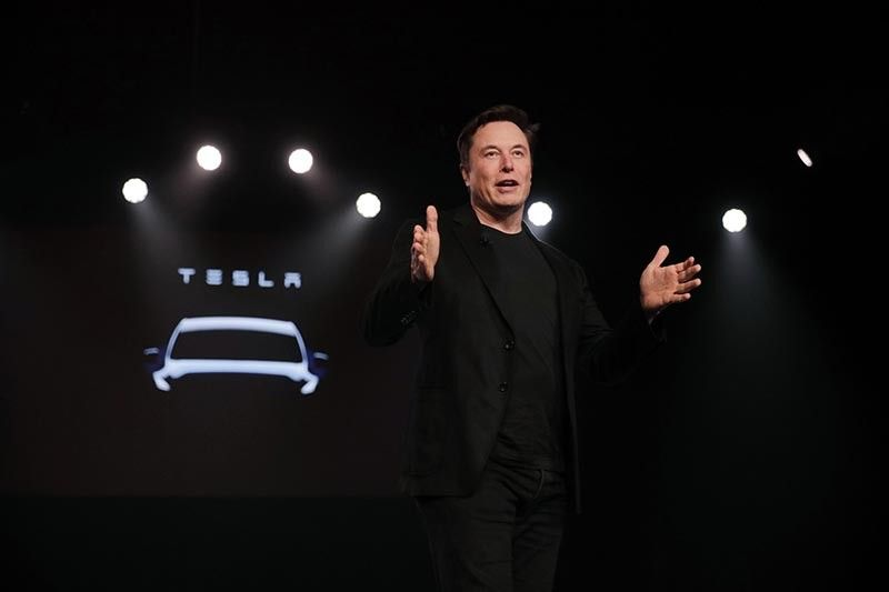 TESLA CHIEF EXECUTIVE OFFICER ELON MUSK during the unveiling of the Model Y at Tesla's design studio in Hawthorne, California last March 14. Musk appears poised to transform the company's electric cars into driverless vehicles in a risky bid to realize a bold vision that he has been floating for years. (AP Photos)