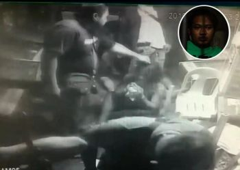 MAULING CAUGHT ON CAM. This screenshot of CCTV footage sent to Superbalita Cebu shows a man being mauled by a group of people bearing firearms. The video sender said the subject of the beating was Eddie Basillote and that the armed men were from the Talamban Police Station. Station chief Police Major  Elisandro Quijano confirmed they had arrested Basillote (inset, shown detained at the Talamban Police Station) in a drug bust on April 18, 2019, but denied that his men were the men in the video. (SunStar photo / Alex Badayos)
